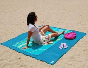 Telo da mare che non trattiene la sabbia